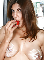 Veronica N presses the juice from a strawberry with her pussy