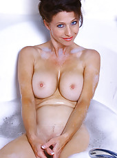 Horny brunette Madison gets herself off in a sudsy bathtub here