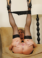 Gorgeous older MILF Carolyn Reese in black fishnet stocking
