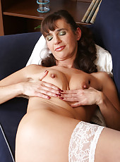 47 year old Suzie from AllOver30 sheds her lace and spreads her pussy
