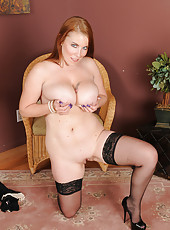 Busty mature redhead Desiree DeLuca parts her stocking clad legs