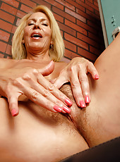 54 year old Erica works out and then spreads her hairy pussy for you