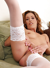 Linda Cain strips off her sexy white lingerie and spreads her legs wide