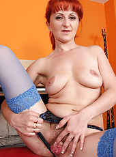 Redheaded Trixi from AllOver30 takes a double headed dildo deep inside