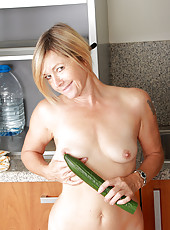 48 year old Susie stuffs a 15 inch cucumber into her mature pussy