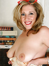 Naturally busty Sunshine E plays with her boobs at the office