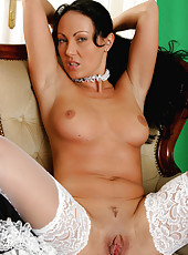 Brunette MILF in a maids outfit dusts off her swollen pussy