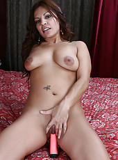 Sexy and exotic Lola slides her mature pussy down on her pink toy