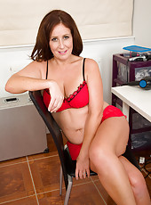 47 year old Carol Foxwell massages her pussy at the makeup table