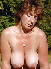 Busty 42 year old Misti gets her mature pussy plugged outdoors