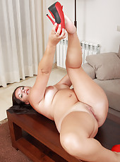 31 year old MILF Lara Marinez spreads and probes her meaty pussy