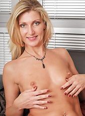 Blonde MILF Yasmin wastes no time getting naked after her 9 to 5 job