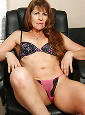 Exclusive mature Andie from AllOver30 pulls aside her panties