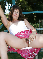 41 year old Andie shows her mature bush while playing in the park