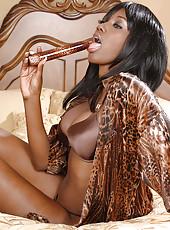 Gorgeous ebony MILF stuffs her pussy with a fancy plastic vibrator