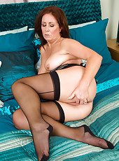 Gorgeous Carol Foxwell slips out of her black lingerie to put on a show