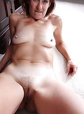 Elegant Jay Dee from AllOver30 strips and spreads her mature pussy