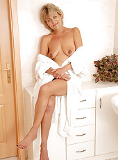 45 year old housewife Sherry D opens her robe and gives us a peek