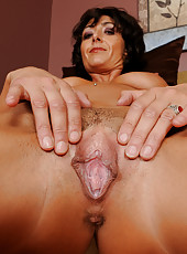 37 year old Coral from AllOver30 pulls her mature shaven pussy wide