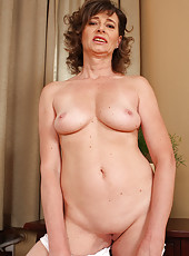 50 year old Judita loves to show off her body after dusting the house