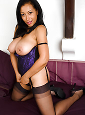 Exotic MILF Danica slips a shiny glass dildo inside her tight pussy