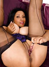 Exotic MILF Danica slips a shiny glass dildo inside her tight pussy