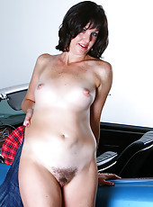 Hot brunette MILF Sydney lights up a cigarette and shows pussy