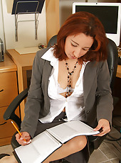 Hot redheaded Mexican MILF Cynthia spreads at the office