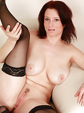 Redheaded housewife with big natural tits wearing lacy black stockings