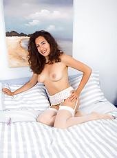 Hairy bushed Isabelle from AllOver30 probes her hot pussy with a toy
