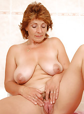 All natural MILF Misti from AllOver30 spreading her large hairy pussy