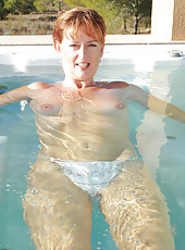 Redheaded MILF Liddy from AllOver30 decides to go skinny dipping