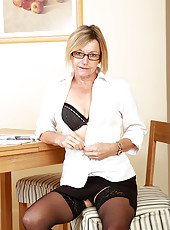 Hot 49 year old Susie slips off her working clothes to spread her pussy