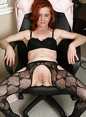 Redheaded office girl looks great naked at 53 years old