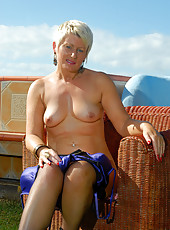 Sexy 44 year old Sally T probes her hot  wet and mature pussy outdoors