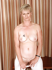 Blonde 42 year old Nicole M strips off her tights and spreads her box
