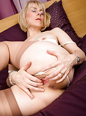 63 year old Hazel pulls her panties aside to display a full bush