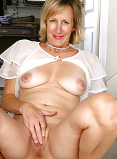 43 year old Julia shows her mature body through white lingerie