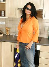 Brunette MILF eats shipped cream from her huge jugs