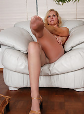 Hot older lady in nylons exposes her furry beaver