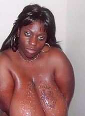 Massive boobs on ebony babe Simone Fox in the shower