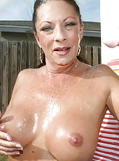Meet the neighborhood milf Margo Sullivan, who loves nothing more than jacking off big huge cocks until they erupt mountains of man goo