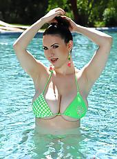 Busty legend Karina Heart gets wet