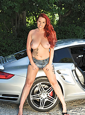 Gorgeous redhead drives in sportcar