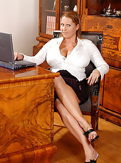 Boss lady enjoys her big breasts!