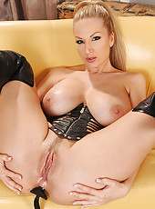 Carol toying pussy & ass in latex