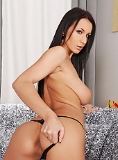 Black-haired Roxy Taggart toying