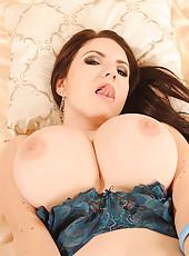Busty babe Karina Heart stripping