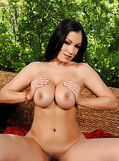 Busty Aria Giovanni posing outdoors