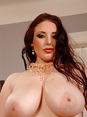 Angela White squeezing her boobs